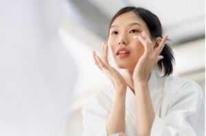 an Asian girl is washing her face
